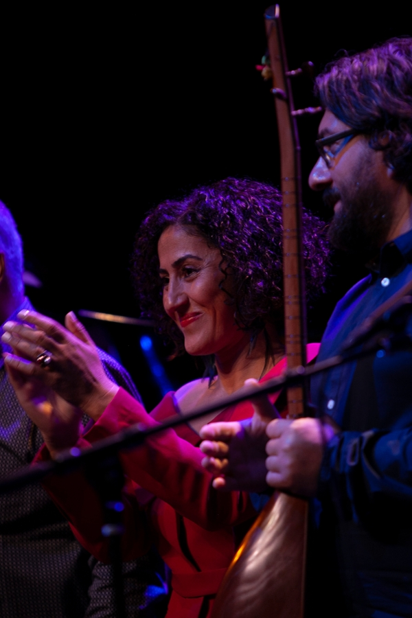 Aynur stands with her fellow musicians at the end of the performance.